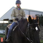 Lauren Lilly Camp Ondessonk Equestrian Coordinator with fairway